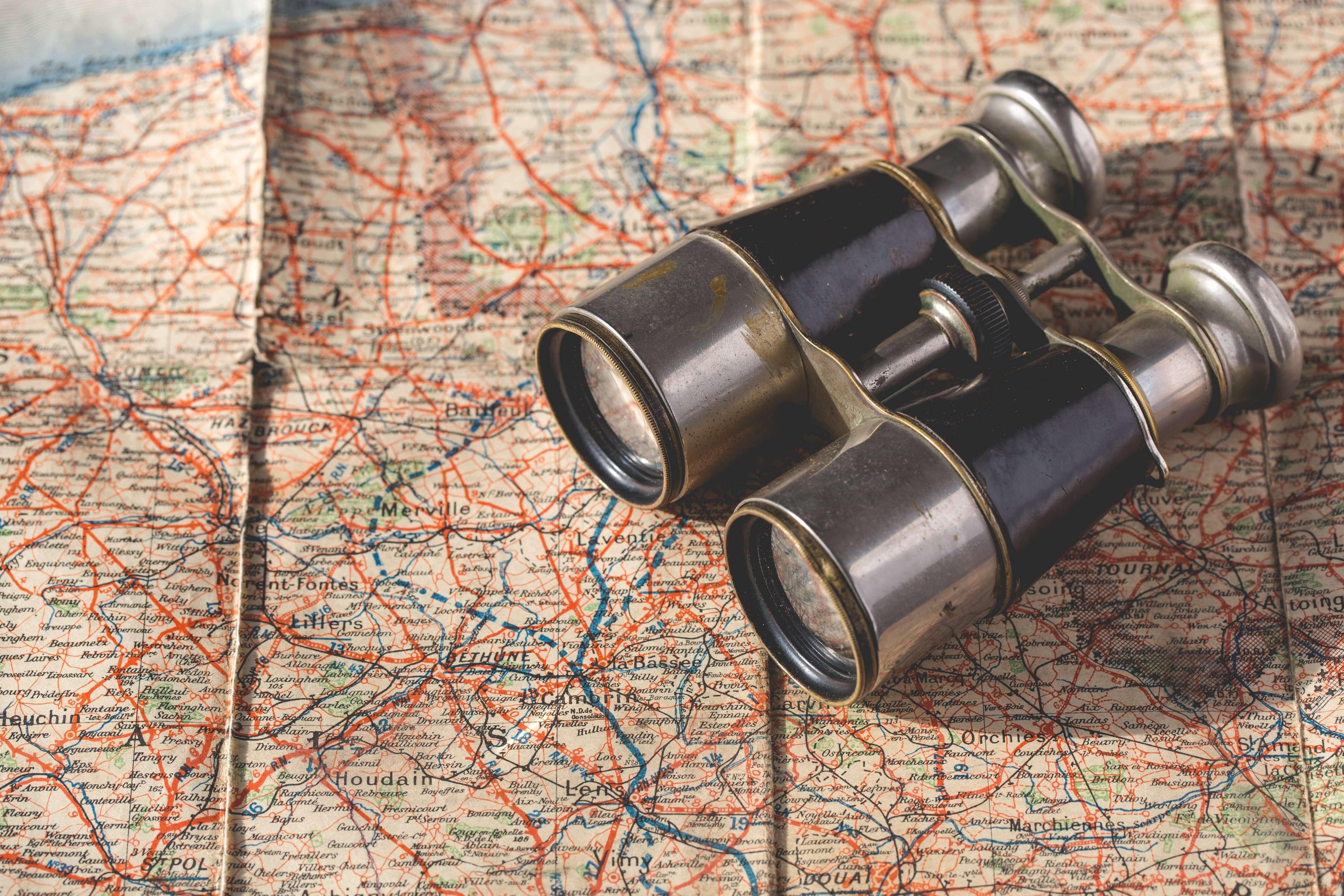 Binoculars on a map